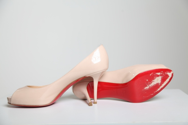Our new red soles after one outing